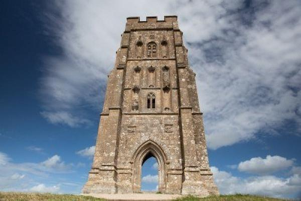 8548693-tourists-exploring-the-ruins-of-st-michael-s-tower-at-the-top-of-glastonbury-tor-in-somerest-england.jpg